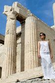 Woman near Propylaea Columns Acropolis Athens Greece on sky back — Stock Photo