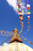 Stupa with buddha eyes and prayer flags on clear blue sky backgr — Stock Photo