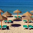 Stock Photo: Parasol and sun loungers on beach