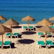 Stock Photo: Parasol and sun loungers on the beach