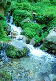Water stream movement on the stone background — Stock Photo