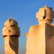 Famous chimneys at Casa Mila (also called La Pedrera) by Antoni Gaudi — Stock Photo #16210373