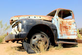 Old and rusty car wreck at the last gaz station before the Namib — Stock Photo