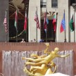 Stock Video: Rockfeller Center Plaza, Flags waving at wind, NYC