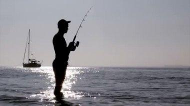 Sunset fisherman silhouette at Ria Formosa wetlands natural conservation region landscape, Algarve, southern Portugal. — Stock Video