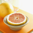 Whole and Halved Grapefruit — Stock Photo #16906057