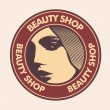 "Emblem ""beauty shop"" with woman face. — Vector de stock"
