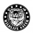 "Emblem ""wildlife saver"" with tiger head. - Stock Vector"