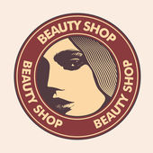 "Emblem ""beauty shop"" with woman face. — Stock Vector"