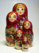 Beautiful Russian Matreshka with Russian traditional bread — Stock Photo