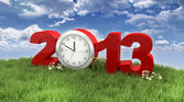 Year 2013 with Clock in the Grass under the Sky — Stock Photo