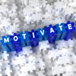 Creative 3D pieces of puzzle and word Motivate - Stock Photo
