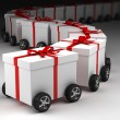 Gift boxes convoy on wheels — Stock Photo
