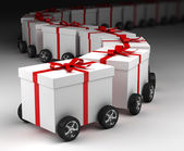 Geschenk dozen konvooi op wielen — Stockfoto