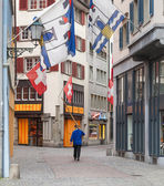 Zurich, a person with an alphorn in the old town — Stock Photo