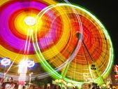 Big wheel in motion — Stock Photo