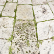 Weathered stones pavement — Stock Photo