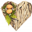 Stock Photo: Easter nest with twio eggs and feathers on sweet-heart