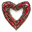 Heart-shaped christmas or St. Valentine wicker wreath — Stock Photo
