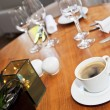 Cup of coffee on wooden table — Stock Photo #15695695