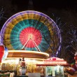 Ferris Wheel at amusement Christmas fair - Stock Photo