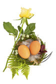 Easter nest with two eggs and feathers — Stock Photo