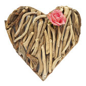 Hand-made ornamental heart made of dry sticks — Stock Photo
