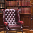 Chesterfield chair in the library — Stock Photo #15881615