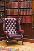Chesterfield chair in the library — Stok fotoğraf