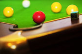 Pool game on green table — Stockfoto
