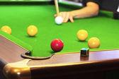 Basen gra na zielony stół — Zdjęcie stockowe