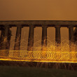 Stock Photo: Sparking fire rings on National Monument, Edinburgh, Scotland.