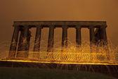 Sparking fire rings on National Monument, Edinburgh, Scotland. — Stock Photo