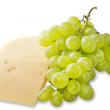 Cheese and grapes on a white background — Stock Photo