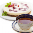 A cup of tea with cheesecake — Stock Photo