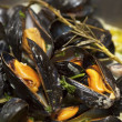 Stock Photo: Mussels being cooked in buttery sause close-up