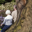 Elderly couple in the park — Stock Photo
