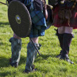 Lower part of medieval scottish warriors — Stock Photo #16782105
