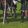 Lower part of medieval scottish warriors — Stock Photo #16782145