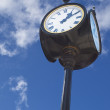 Royalty-Free Stock Photo: Old street clock over blue sky background
