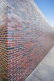Abstract perspective of tall brick wall — Stock Photo