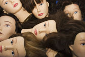 Mannequin heads with wigs — Stock Photo