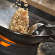 Cooking asian stir fry in wok — Stock Photo #16962569