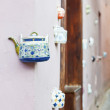 A teapot embedded into the facades of tea-shop — Stock Photo