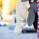 Hanging handmade knit socks — Stock Photo #16963643