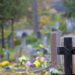 Granite cross on Christian cemetery — Stock Photo