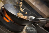 Cooking asian stir fry in wok — Stock Photo