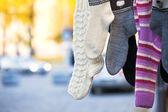 Hanging handmade knit socks — Stock Photo