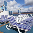 Roe of deck chairs on sundeck of the cruise ship - Stock Photo