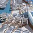 Roes of deck chairs on sundeck of the cruise ship by the pool — Stock Photo